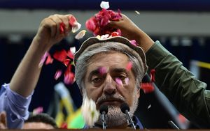 Afghan presidential candidate Abdullah Abdullah is showered with rose petals by supporters at a rally in Kabul.