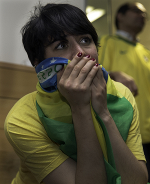 A Brazil fan reacts to the team's 7-1 defeat to Germany in 2014.