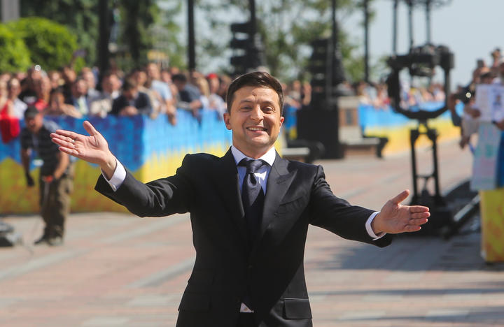 Ukraine's new President Volodymyr Zelensky greets people as he arrives at the parliament for a ceremony of his oath during the inauguration ceremony in Kyiv, Ukraine, May 20, 2019. Newly elected President of Ukraine Volodymyr Zelensky sworn in as Ukraine's president.