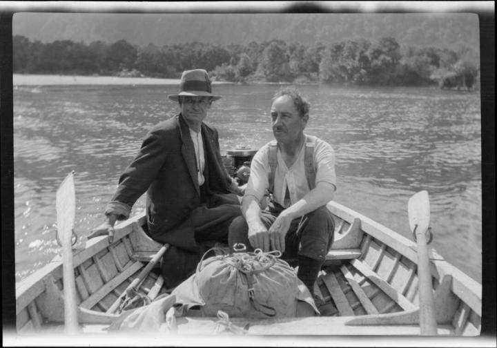 Archive photo of two men in a rowboat, taken 1922.