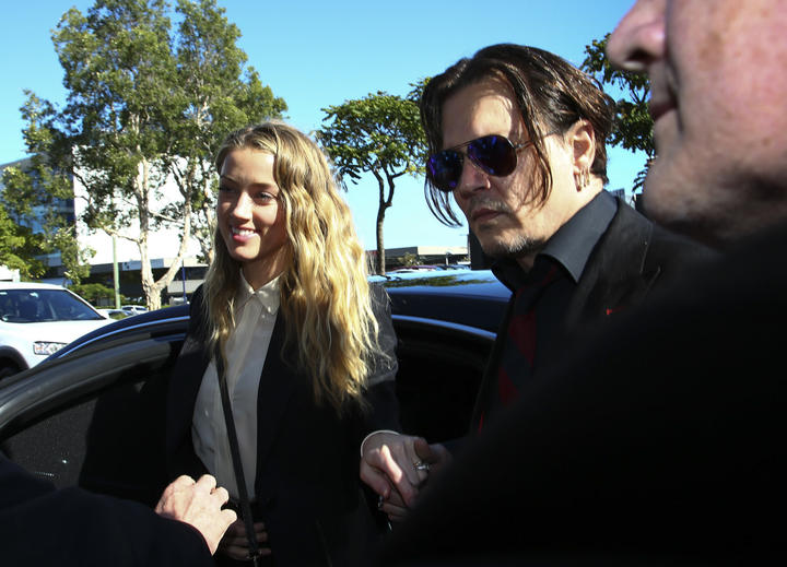 Johnny Depp and Amber Heard in Australia in April 2016, arriving at court over Heard's alleged illegal importation of their two Yorkshire terrier dogs Boo and Pistol into the country in a private jet in 2015.