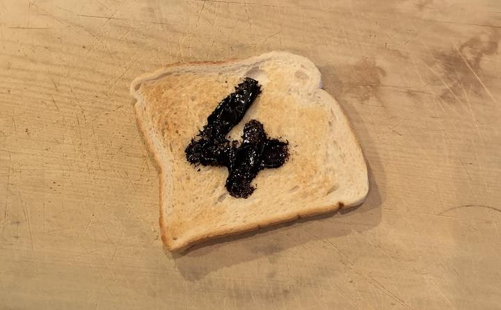 Toast with marmite spread on it to form the number 4