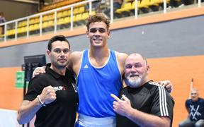 David Nyika with New Zealand coaches Thomas Rangiawha and Billy Meehan.