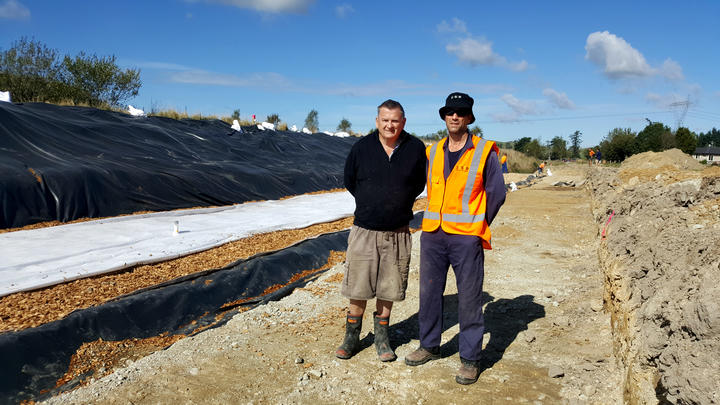 John Saywell and Lee Burbery beside the woodchip bioreactor