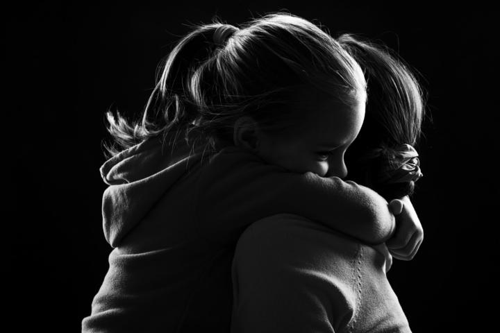 44113713 - black and white image of a little girl hugging her mother