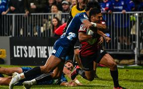 Richie Mo'unga of the Crusadersis tackled by Melani Nanai of the Blues to stop a try during the Super Rugby match, Crusaders V Blues at Christchurch Stadium, Christchurch, New Zealand, 25th May 2019.Copyright photo: John Davidson / www.photosport.nz