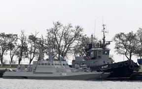 FILE - In this Monday, Nov. 26, 2018 file photo, three Ukrainian ships are docked near the Kerch after been seized on Sunday, in Kerch, Crimea.