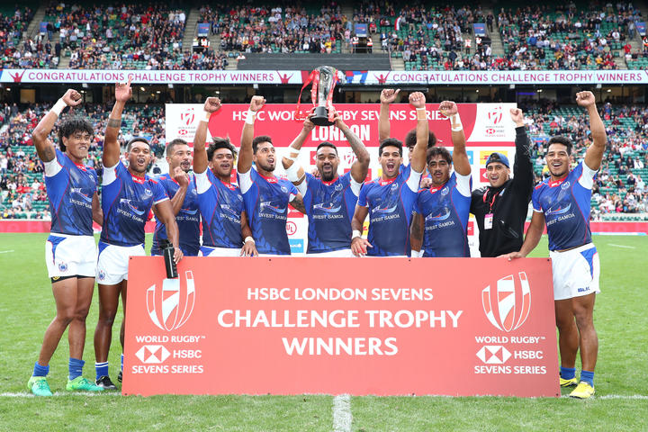 Samoa celebrate their Challenge Trophy Final win over Scotland.