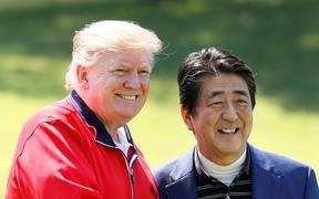 US President Donald Trump, left, and Japan's Prime Minister Shinzo Abe before playing a round of golf at Mobara Country Club in Chiba.