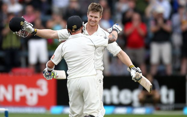 Jimmy Neesham hugs Blackcaps Captain, Brendon McCullum after scoring his maiden test century during the 2nd cricket test between the Black Caps & India in Wellington in February.