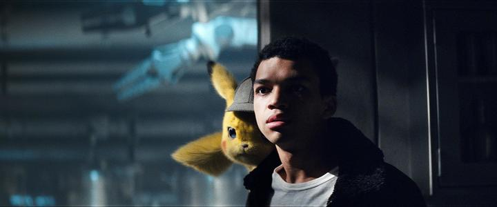 Justice Smith as Tim Goodman with Detective Pikachu (voiced by Ryan Reynolds) in the deerstalker. Check out that film grain!