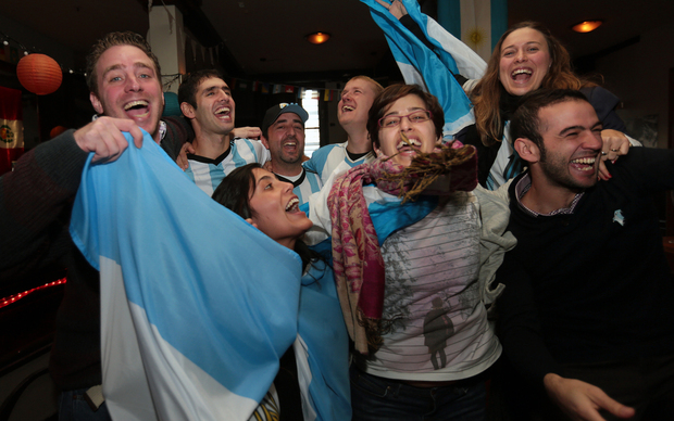 Argentinian fans in Wellington celebrate victory against the Netherlands in the semi finals of the 2014 Football World Cup.