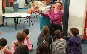 Reading in the library at Karori West Normal School