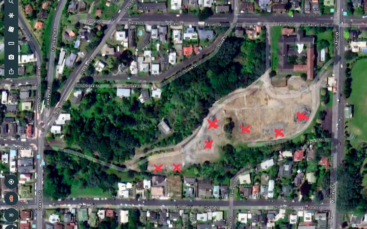 Ariel view of the former Barrett Street Hospital site in New Plymouth with piles of asbestos and lead contaminated soil marked.