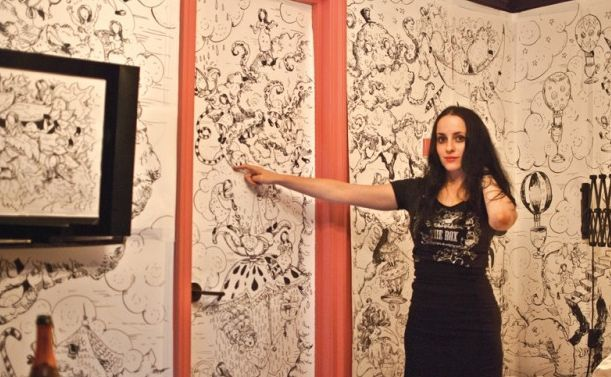 Molly Crabapple with the work she created during her Week in Hell.