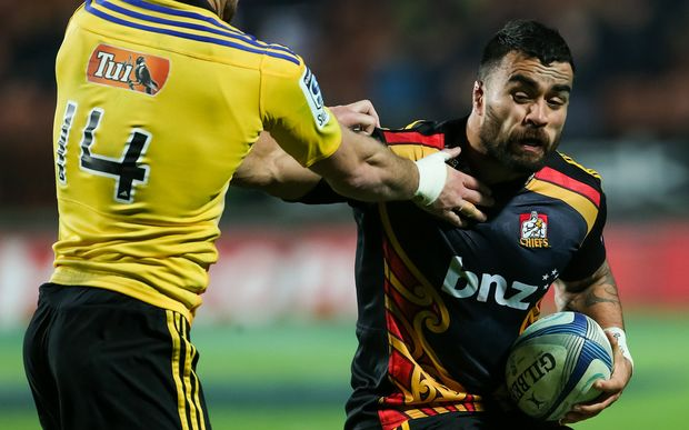 Chiefs captain Liam Messam fends off Hurricanes' Cory Jane during the Super 15 Rugby match at Waikato Stadium, Hamilton, in July.