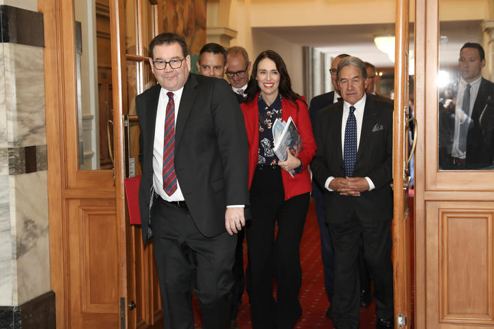 Grant Robertson, Jacinda Ardern, Winston Peters and others on their way to the debating chamber for budget 2019