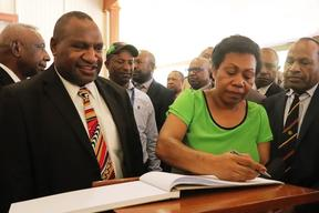 James Marape and his wife Rachael Marape signing the visitors book at Government House after arriving for his swearing in as Prime Minister of PNG.
