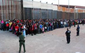 A photo released by US Customs and Border Protection shows migrants who crossed the US-Mexico border in El Paso, Texas