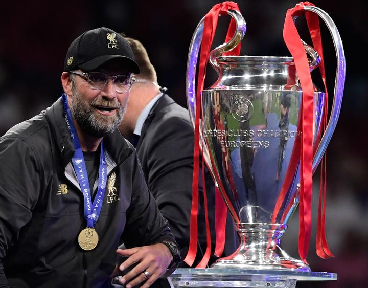 Liverpool's German manager Jurgen Klopp looks at the trophy after winning the UEFA Champions League final football match between Liverpool and Tottenham Hotspur  in Madrid
