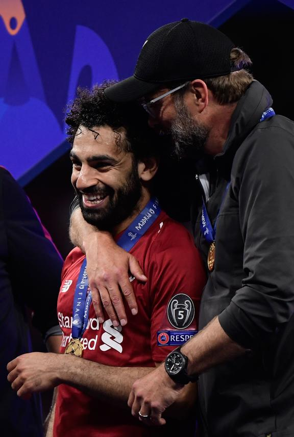 Liverpool's German manager Jurgen Klopp (R) and Liverpool's Egyptian midfielder Mohamed Salah celebrate after winning the UEFA Champions League final football match between Liverpool and Tottenham Hotspur