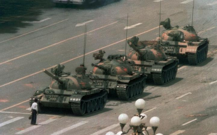 FILE - In this June 5, 1989, file photo, a Chinese man stands alone to block a line of tanks heading east on Beijing's Changan Blvd. in Tiananmen Square