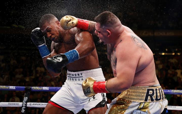 Andy Ruiz Jr (R) lands a blow to the head of Anthony Joshua in their World heavyweight title fight in New York.