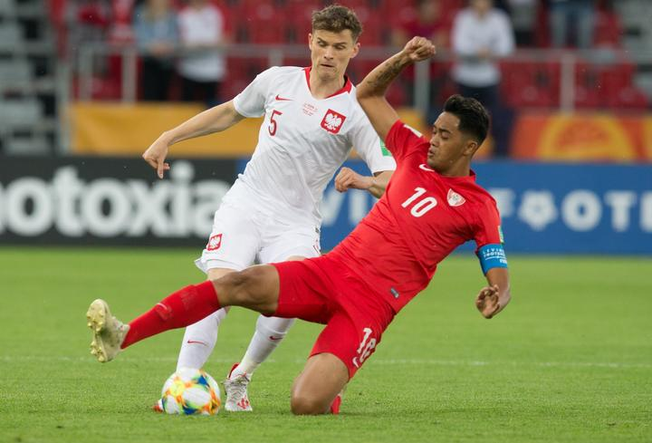 Tahiti's Roonui Tehau battles for possession with Poland's Serafin Szota during their FIFA U-20 World Cup group A match.