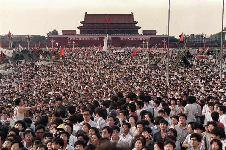 (FILES) This file photo taken on June 2, 1989 shows people gathered at Tiananmen Square during a pro-democracy protest in Beijing. -
