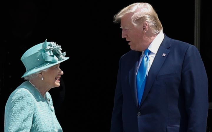Britain's Queen Elizabeth II speaks with US President Donald Trump during a welcome ceremony at Buckingham Palace.