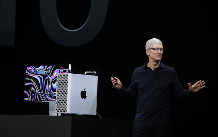 Apple CEO Tim Cook speaks about the MacBook Pro at the Apple Worldwide Developers Conference in San Jose, Calif.