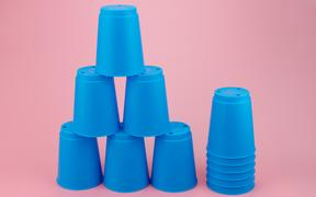 blue stacks plastic cups. Speed stack cup on pink background