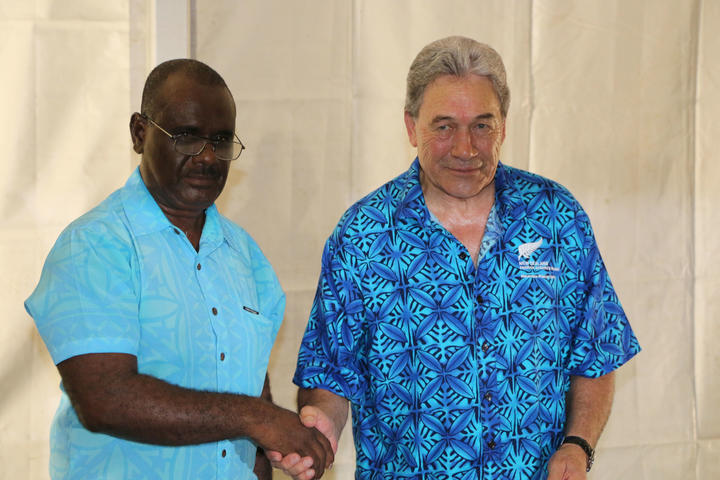 The foreign affairs ministers of New Zealand and Solomon Islands, Winston Peters (R) and Jeremiah Manele (L) shake hands after signing an agreement   for continued support in Honiara. June 2019