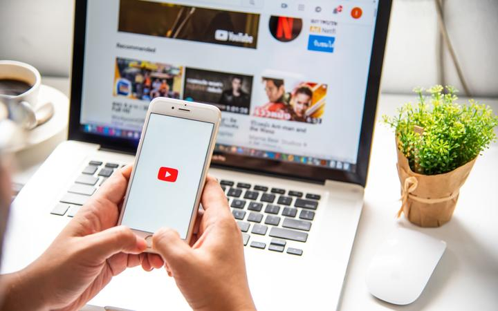 In a hand for man with social networking service Youtube on the screen IPhone6. YouTube is the popular online video sharing website.