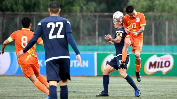 Guam captain Jason Cunliffe challenges for the ball during the Matao's FIFA World Cup and Asian Cup first round qualifying match in Bhutan.
