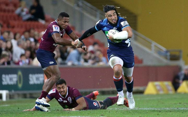 Ma'a Nonu makes a break against the Reds in Brisbane.