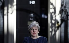 FILE - In this Tuesday, April 18, 2017 file photo, Britain's Prime Minister Theresa May arrives to speak to the media outside her official residence of 10 Downing Street in London.