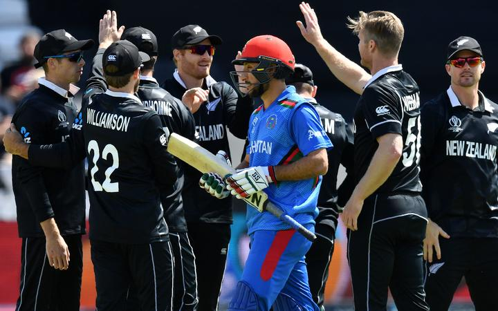 The Black Caps celebrate the wicket of Rahmat Shah in their World Cup pool match in Taunton.