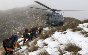Teams 17 and 20 are extracted from Tarn Ridge in the Tararua Ranges during the search for missing tramper Darren Myers.