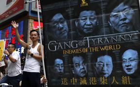 A banner targeting Chinese leadership in protests against a proposed amendment to extradition laws in Hong Kong. (AP Photo/Vincent Yu)
