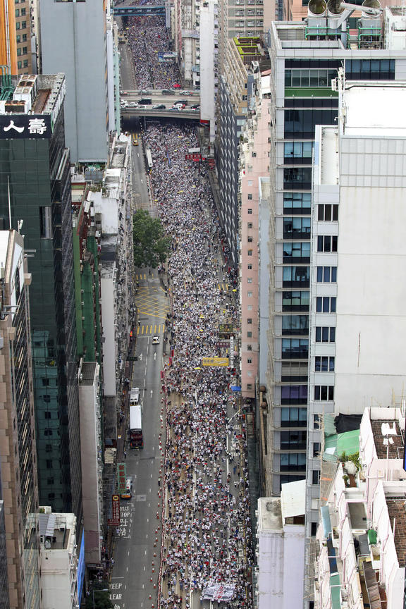 Thousands of protesters march in a rally against the proposed amendments to an extradition law in Hong Kong, Sunday, June 9, 2019.