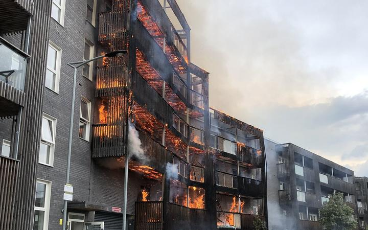 Investigation launched after fire destroys 20 London flats