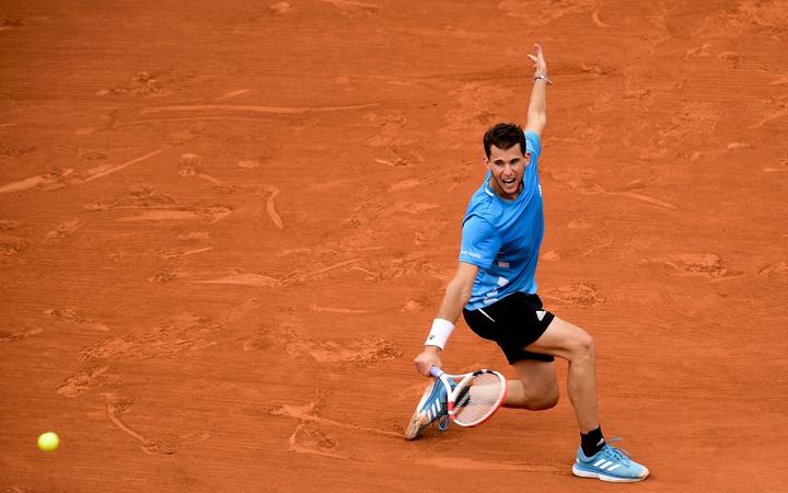 Dominic Thiem plays a return shot against Rafael Nadal in the final of the 2019 French Open.
