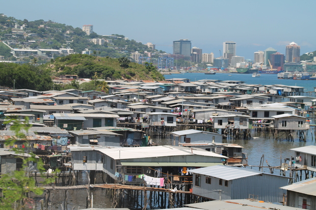 Hanuabada, the original village of Papua New Guinea's capital city Port Moresby inhabited by the Motuan people; with the CBD in the background.