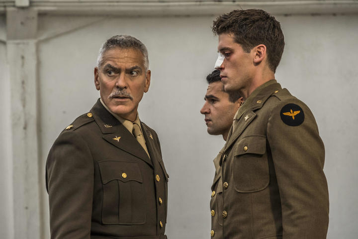 Yossarian (Christopher Abbott), and Clevinger (Pico Alexander), experiencing some military discipline from Scheisskopf (George Clooney), before shipping out Italy in Catch-22.