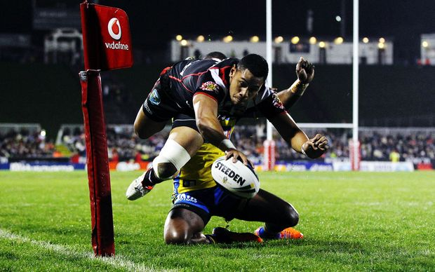 David Fusitua of the Warriors scores a try against the Eels at Mt Smart Stadium.