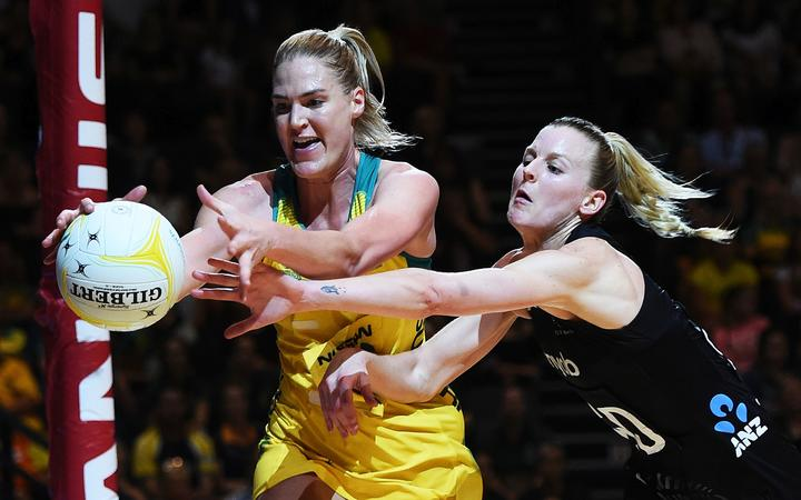 Diamonds goal shooter Caitlin Bassett (L) Silver Ferns defender Katrina Rore (R)