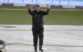 Head Groundsman, Lee Fortis, goes to work in a hailstorm during the first one day international between England and Pakistan at the Kia Oval,