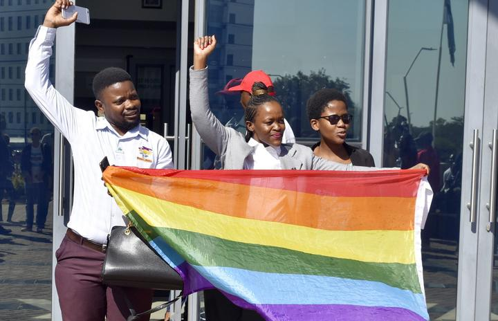 Activists celebrate outside the High Court in Gaborone, Botswana, Tuesday June 11, 2019. Botswana became the latest country to decriminalize gay sex