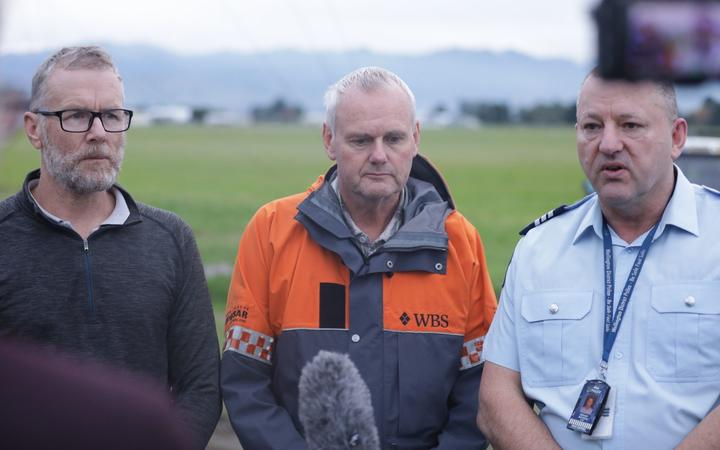 From left: Darren Myers' brother-in-law Duncan Styles, Murray Johnson from LandSAR, and Sergeant Tony Matheson